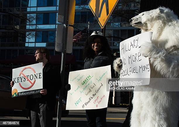 Environmental activists protest against the proposed Keystone XL pipeline in front of the Center for Strategic and International Studies where former...