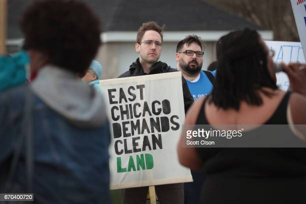 Environmental activists protest outside the Carrie Gosch Elementary School during a visit by US EPA Adminstrator Scott Pruitt on April 19 2017 in...