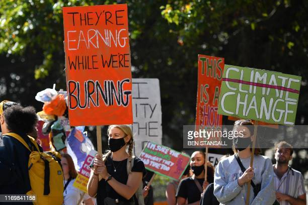 Environmental activists rally during the UK Student Climate Network's Global Climate Strike protest action in central London on September 20 2019...