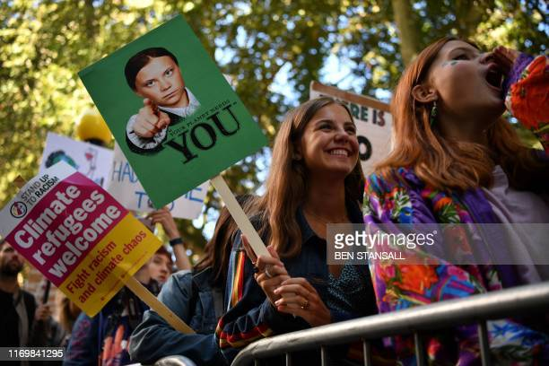 TOPSHOT Environmental activists rally during the UK Student Climate Network's Global Climate Strike protest action in central London on September 20...