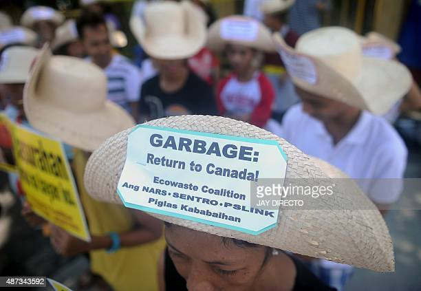 Environmental activists rally outside the Philippine Senate in Manila on September 9 2015 to demand that scores of containers filled with household...
