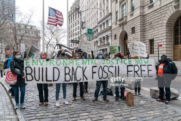 Environmental activists rally to demand Build Back Fossil Free in front of Charging Bull sculpture on Broadway. Rally was organized by Food & Water...