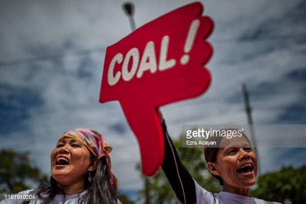 Environmental activists take part in a protest calling on the Group of 20 nations to end funding for coal and fossil fuels, outside the Embassy of...