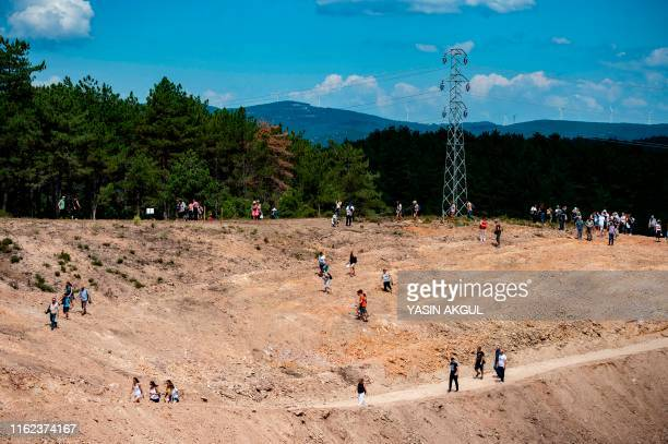 Environmental activists walk at the gold mine site project by Canadabased Alamos Gold in a deforestated area in Turkey's northwestern province of...