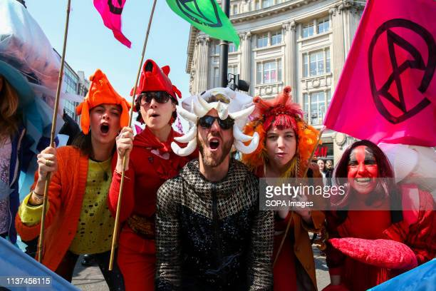 Environmental activists wearing fancy dress costumes are seen shouting slogans during the demonstration Activist protest at the Parliament Square...