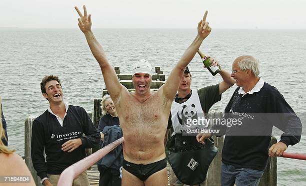 Environmental campaigner Lewis Gordon Pugh celebrates as he arrives at Southend Pier on August 6 2006 at SouthendonSea England Pugh has become the...