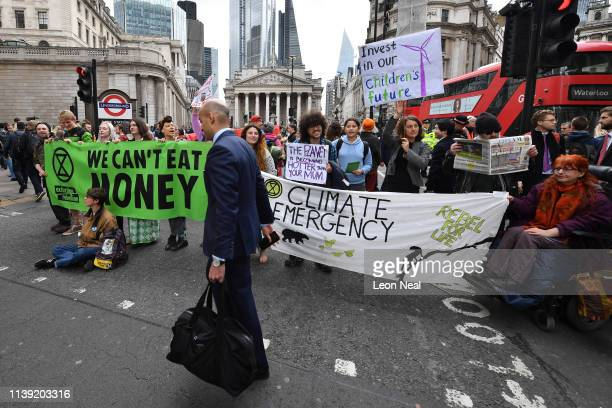 Environmental campaigners from the Extinction Rebellion group block the junction at Bank as part of their ongoing actions and protests across the...