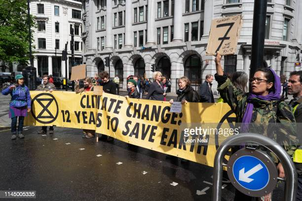 Environmental campaigners from the Extinction Rebellion group block the junction near the Bank of England as part of their ongoing actions and...