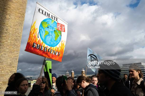 Environmental campaigners from the Extinction Rebellion group march from Southwark Cathedral before blocking a series of roads as part of their...