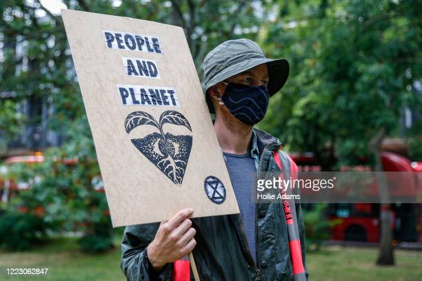 Environmental campaigners gather outside the HS2 site near Euston Station on June 27 2020 in London United Kingdom Climate activist group Extinction...