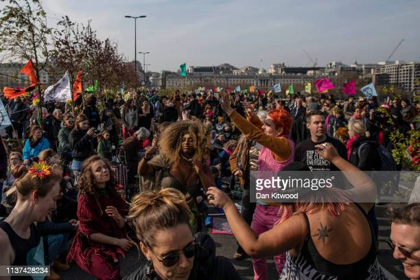 Environmental campaigners take part in a coordinated protest by the Extinction Rebellion group on April 15 2019 in London England With demonstrations...
