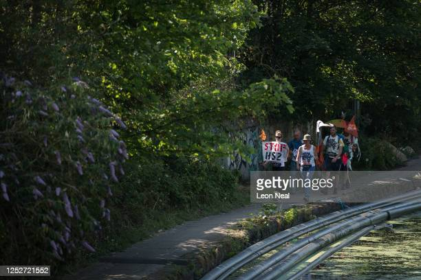 Environmental campaigners walk along the canal towpath before moving on to protest outside the site of the Old Oak Common HS2 site on June 26 2020 in...