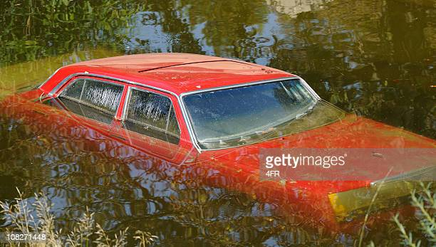 Environmental Change - Car Submerged and Destroyed by Flood