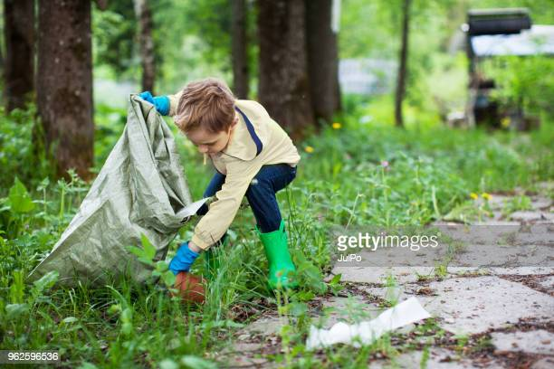 environmental cleanup - picking up stock photos and pictures