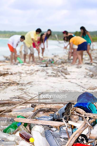 Environmental conscious young people cleaning tropical beach