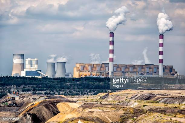 environmental degradation in coal-fired power station in belchatow, poland - coal fired power station stock photos and pictures