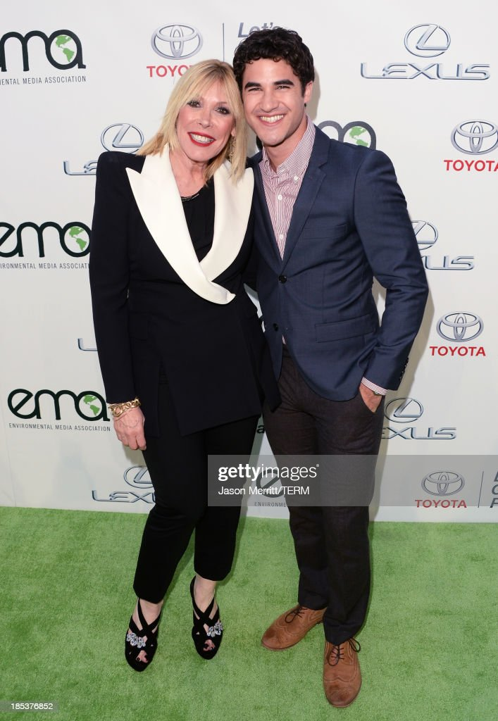 Environmental Media Association President Debbie Levin (L) and actor-singer Darren Criss arrive at the 23rd Annual Environmental Media Awards presented by Toyota and Lexus at Warner Bros. Studios on October 19, 2013 in Burbank, California.