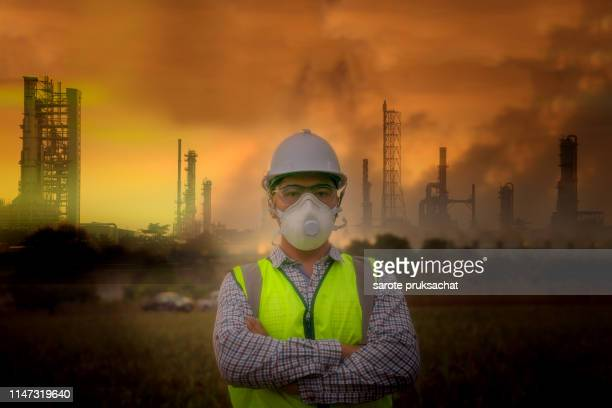 environmental officials put air pollution masks ,environmental problems, pollution industry concept . - fumes stock pictures, royalty-free photos & images