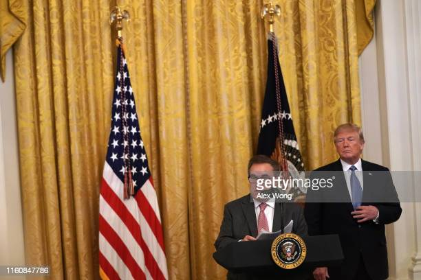 S Environmental Protection Agency Administrator Andrew Wheeler speaks as President Donald Trump looks on during an East Room event on the environment...