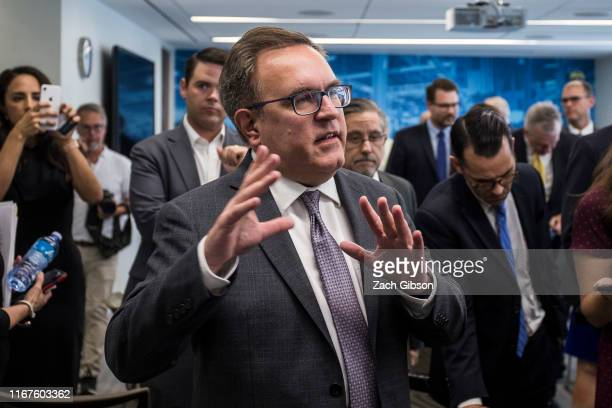 Environmental Protection Agency Administrator Andrew Wheeler talks to members of the news media after a news conference announcing the repeal of...