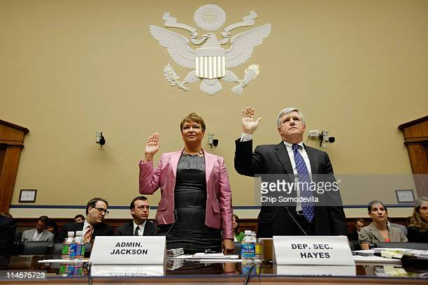 Environmental Protection Agency Administrator Lisa Jackson and Deputy Interior Secretary David Hayes are sworn in before testifying to the House...