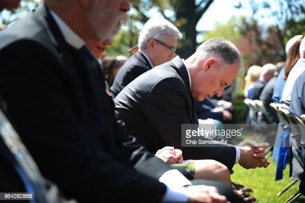 S Environmental Protection Agency Administrator Scott Pruitt and fellow members of President Donald Trump's cabinet bow their heads in prayer during...