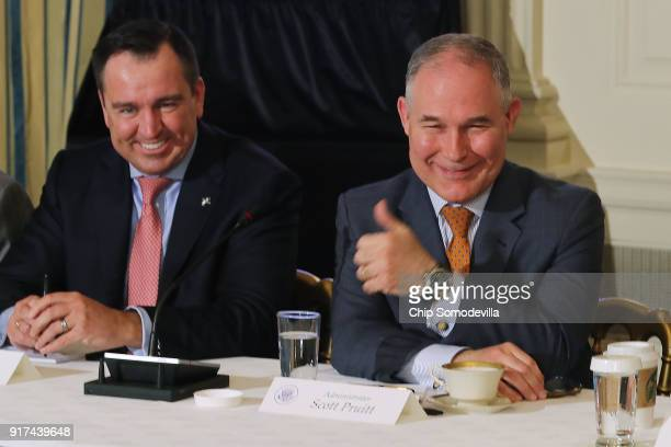 Environmental Protection Agency Administrator Scott Pruitt gives a thumbsup during a meeting with Utah Speaker of the House Greg Hughes and other...