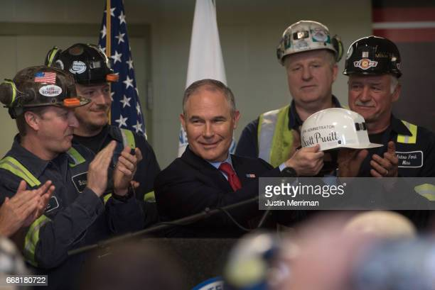 S Environmental Protection Agency Administrator Scott Pruitt holds up a miner's helmet that he was given after speaking with coal miners at the...