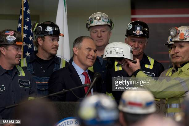 S Environmental Protection Agency Administrator Scott Pruitt looks at a miner's helmet that he was given after speaking with coal miners at the...