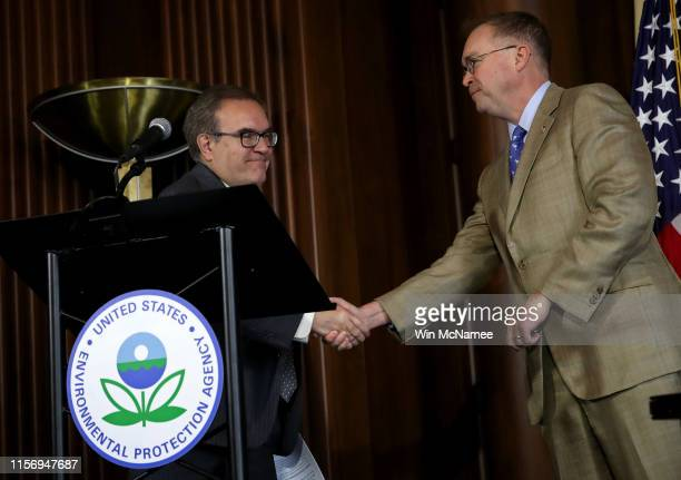 Environmental Protection Agency Administrator Scott Wheeler shakes hands with acting White House Chief of Staff Mick Mulvaney after Wheeler signed...