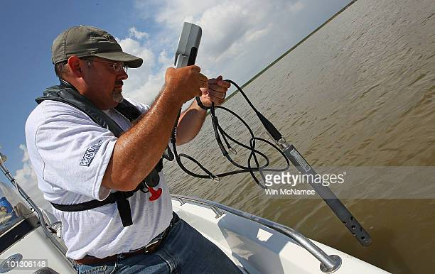 Environmental Protection Agency contractor Andy Kallus tests the water for salinity and oxygenation levels on May 31, 2010 near the point where the...