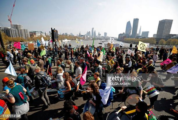 Environmental protesters from the Extinction Rebellion arrive to stage a demonstration on Waterloo Bridge in London on April 15 2019 Environmental...