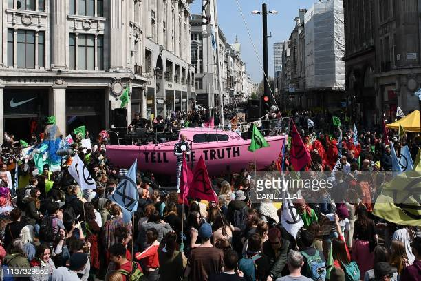TOPSHOT Environmental protesters from the Extinction Rebellion group gather around a pink boat as they take part in a demonstration at the junction...