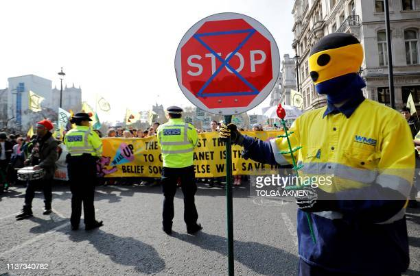 Environmental protesters from the Extinction Rebellion group stage a demonstration in Parliament Square London on April 15 2019 Environmental...