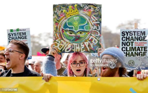TOPSHOT Environmental protesters from the Extinction Rebellion group stage a demonstration in Parliament Square London on April 15 2019 Environmental...