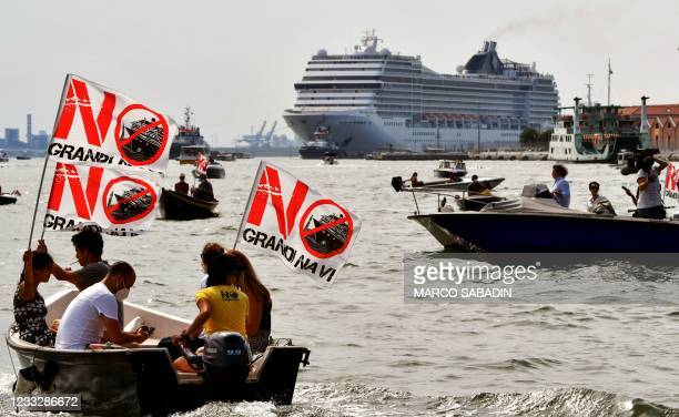 """Environmental protesters from the """"No Grandi Navi"""" group, demonstrate aboard small boats against the presence of cruise ships in the lagoon, as the..."""