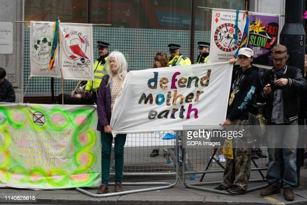 Environmental protesters seen holding a banner during the campaign The protest was to show solidarity with the Amazon rainforest Vivienne Westwood...