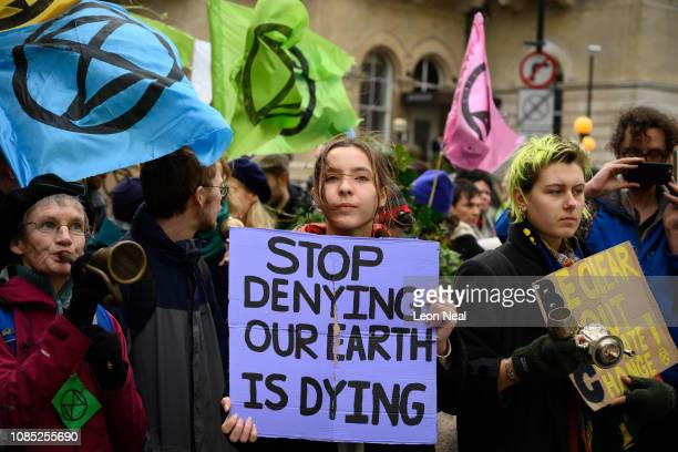 Environmental protestors from the Extinction Rebellion group chant during a demonstration outside BBC Broadcasting House on December 21 2018 in...