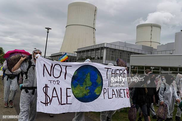 Environmentalist activists march to 'Schwarz Pumpe' power plant as they protest near WelzowSued mine to demand the end of the use of coal for energy...