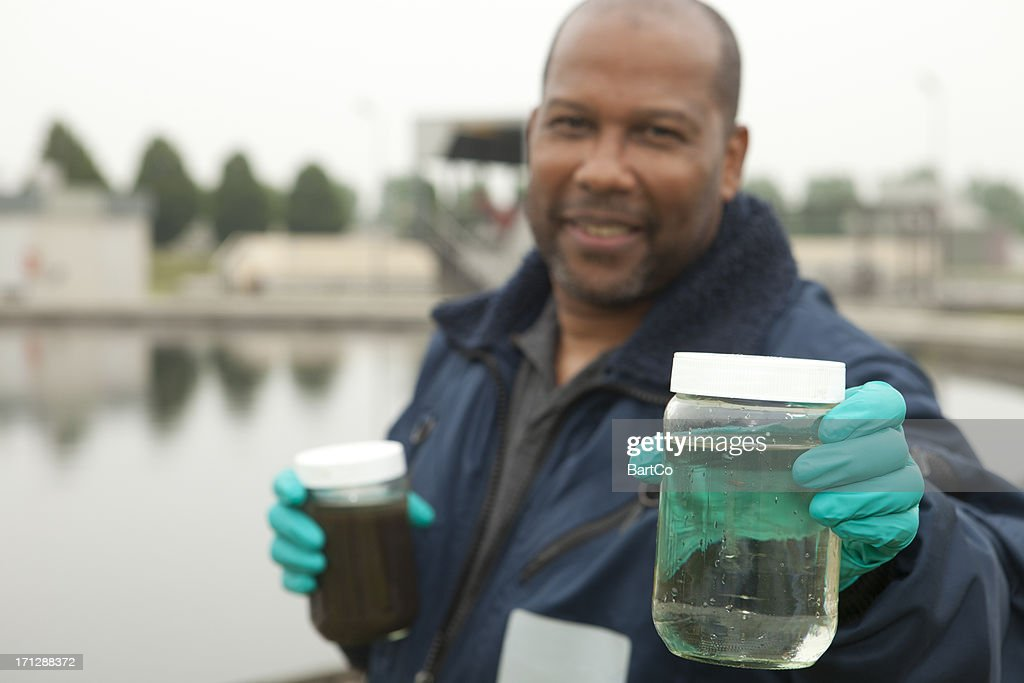 Environmentalist at sewage treatment plant : Stock Photo