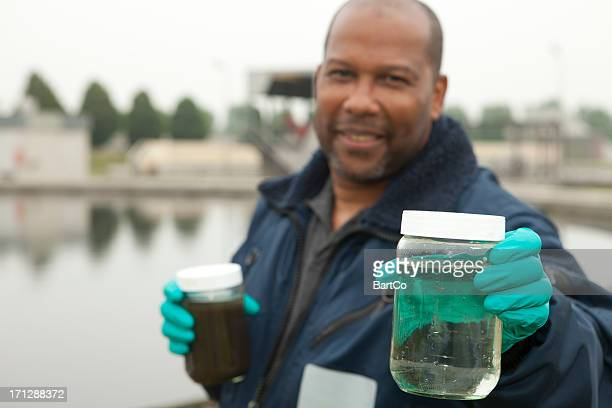 environmentalist at sewage treatment plant - sewer stock pictures, royalty-free photos & images