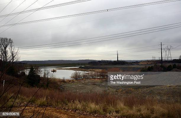 Environmentalist Dean Naujoks who joined Potomac Riverkeeper Network in 2015 as the Potomac Riverkeeper points out the coal ash pond D which he says...