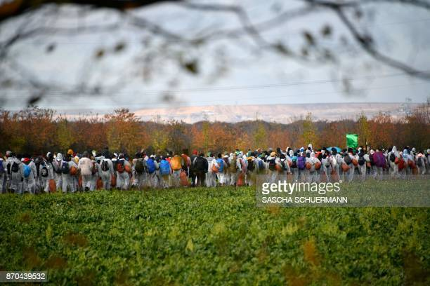 Environmentalist march close to a lignite open pit mine near Elsdorf western Germany on November 5 as they protest against fossilbased energies like...