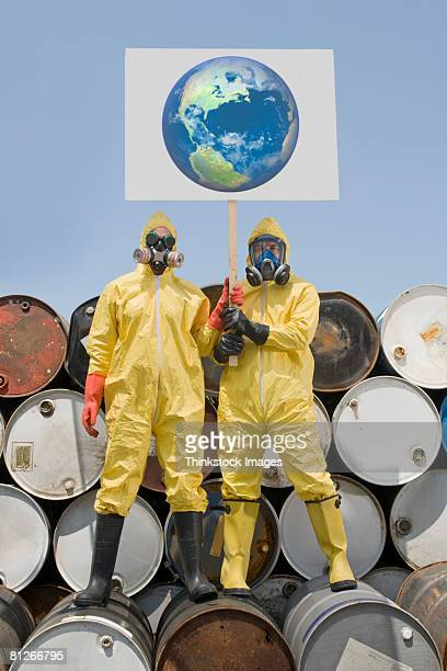 Environmentalist protesters in protective clothing