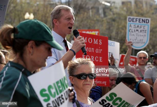 Environmentalist Tom Steyer speaks during a protest outside the White House March 28 2017 in Washington DC Activists protest against President...