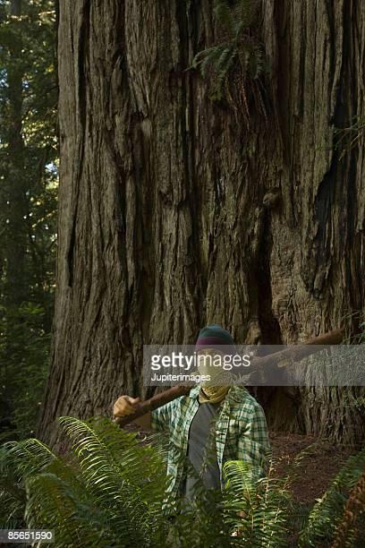 environmentalist wearing bandana in forest - aktivist stock-fotos und bilder