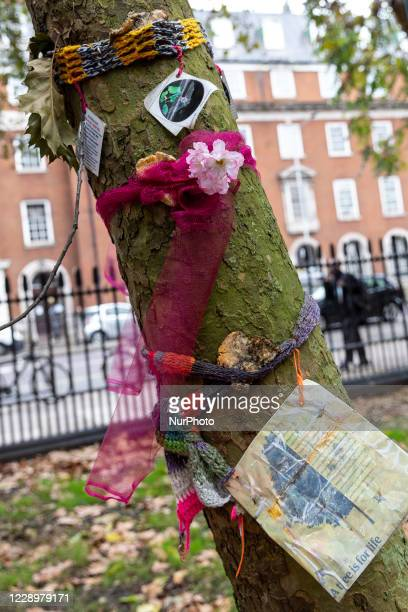 Environmentalists, including members of ExtinctionRebellionprotest against the High Speed 2 project at Euston park, London, England on October 9,...