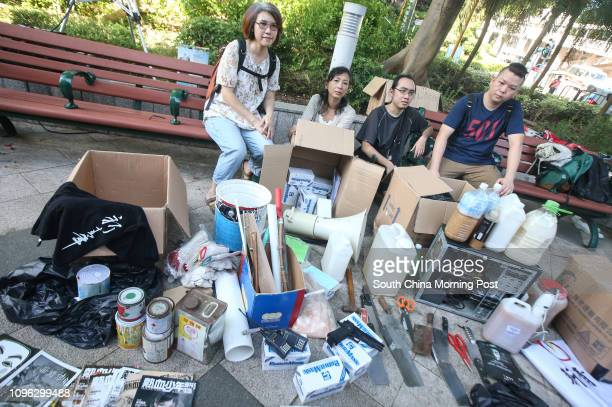 Environmentalists Jess Chan Felicity Ching Ho Waisum and Ryan Tong Chungyan display items seized by police in February a day following the Mong Kok...
