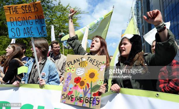 Environmentalists stage a demonstration to draw attention to global warming and climate change in Brussels Belgium on May 12 2019 Demonstrators...
