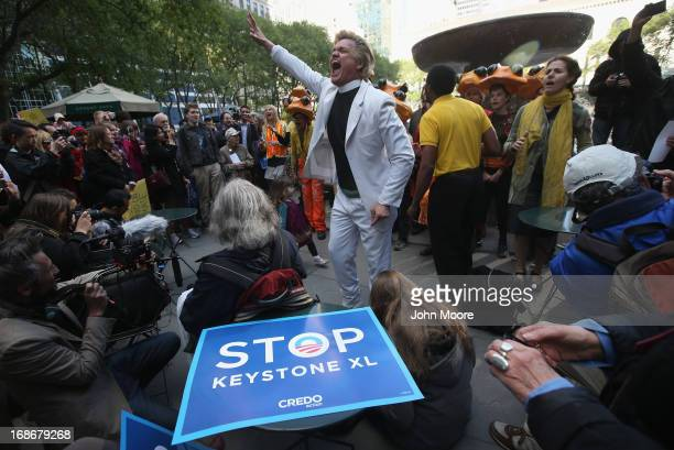 Environmentalists stage a protest to coincide with a fundraising event by US President Barack Obama on May 13 2013 in New York City Hundreds of...